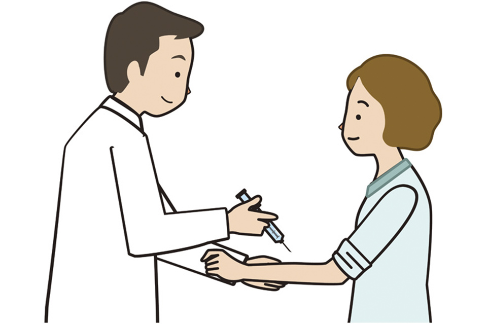 静脈注射を受ける女性の画像